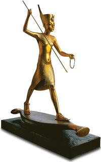 "Skulptur ""Tutanchamun mit Harpune"", handvergoldet"